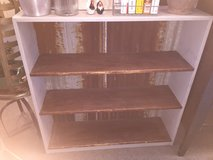 Repurposed bookcase with old metal backing in Elgin, Illinois
