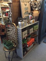 Repurposed bookcase with old metal backing in Naperville, Illinois