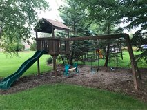 solid redwood deluxe swing set in Elgin, Illinois