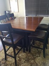 Pub Height Dining Table and 6 Chairs with Built-in Wine Rack in Yucca Valley, California