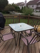 Patio table and four chairs in Naperville, Illinois