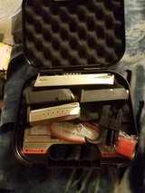 4 mags to Glock 40 and set of grips and one extended mag and s&w 9 mag case and lock in Manhattan, Kansas
