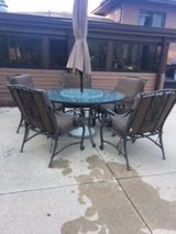 Outdoor Patio Table and 5 chairs with brown cushions and protective weather cover in Algonquin, Illinois