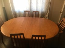 wood dinning room table w/extension and cover and (6)chairs in Yucca Valley, California