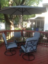 Outdoor table/4 rocker chairs/umbrella with stand and chair pads in Bartlett, Illinois