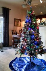 Get an early start for Christmas preparation! 6ft Flocked Pre-lit LED tree in Fort Drum, New York