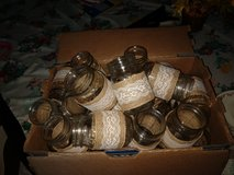 35 pint size Mason jars wrapped in burlap and lace.  Wedding in Byron, Georgia