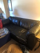 Black pleather couch in Camp Lejeune, North Carolina
