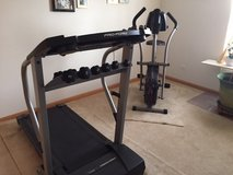 Stationary bicycle and Treadmill with weights in Bolingbrook, Illinois