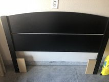 Full sized bed from with black headboard in Manhattan, Kansas
