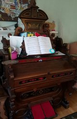 Antique pump organ and bench in Fort Belvoir, Virginia