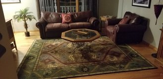 leather couch with matching large chair coffee table and 8x10 area rug in Glendale Heights, Illinois