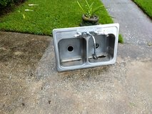 Stainless steel sink w/ faucet and garbage disposal in Baytown, Texas
