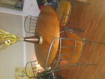 Dining table wooden heavy duty with iron comes with converter from small round to long oval for ... in Pasadena, Texas