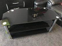 Large black glass TV stand in Lakenheath, UK