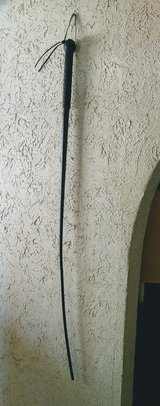 black dressage whip with black rubber grip in 29 Palms, California