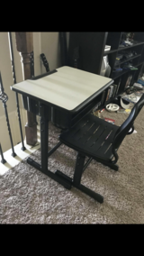 Adjustable Desk with Chair in Kingwood, Texas