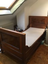 """Very old solid wood twin size """"sleigh"""" bed frame and spring base in Stuttgart, GE"""
