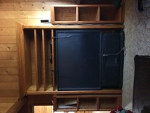 Solid oak entertainment center and big screen  tv in Leesville, Louisiana