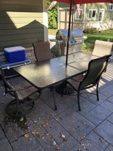 Tropitone patio dining table and chairs in Chicago, Illinois