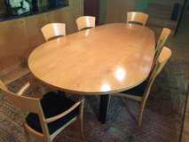 Contemporary Egg Shaped dining table, 8 chairs and sideboard in Naperville, Illinois