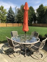 """63"""" round glass outdoor patio table and 6 rocking/swivel chairs with umbrella in Oswego, Illinois"""