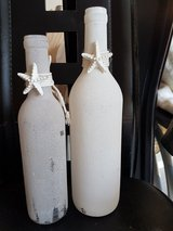 2 decorative bottles with starfish. in Fort Carson, Colorado