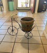 Bike with clay flower pot in Fairfield, California