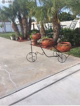 Bike with clay flower pots in Travis AFB, California