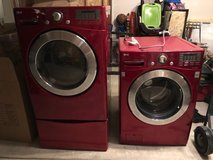LG red front load washer dryer set with pedestals in Bolingbrook, Illinois