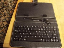 Tablet holder with keyboard in The Woodlands, Texas