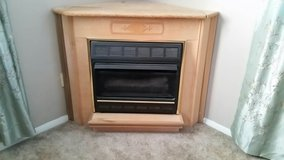 Mini Hearth Propane Fireplace With Corner Mantel in Fort Leonard Wood, Missouri