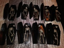 Treat coffins with skeletons in The Woodlands, Texas