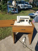 Kenmore Sewing machine in cabinet in Pasadena, Texas