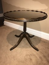 Antique round wood side table in Joliet, Illinois