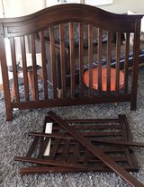 Crib with toddler bed rail in Aurora, Illinois
