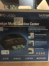 Brother inkjet multi function center with some ink cartridges in Plainfield, Illinois