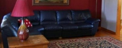 Natuzzi leather sectional couch in Fort Drum, New York
