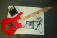 child's electric guitar with Hal Leonard guitar method on disc in 29 Palms, California