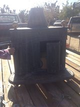 antique wood burning fireplace stove insert in 29 Palms, California