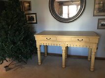 Yellow solid table in Plainfield, Illinois