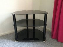 Smoked glass TV stand in Lakenheath, UK