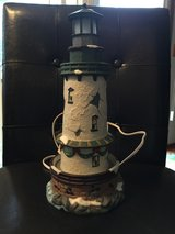 Lighted ceramic light house in Naperville, Illinois