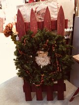 Festive Santa wreath/fence porch decor in Bartlett, Illinois