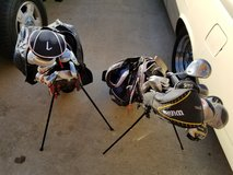 Two sets of golf clubs with bags in DeRidder, Louisiana