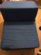 Dark blue fold out chair bed in Lakenheath, UK
