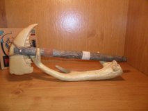 Tomahawk replica of deer jaw & antler stand in Cleveland, Texas