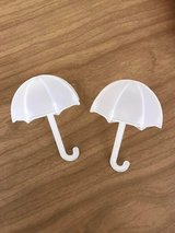 Two Little Plastic Umbrellas in Chicago, Illinois