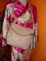 Brand new white leather floral embossed The Sak purse bag retails $155 in Fort Bliss, Texas