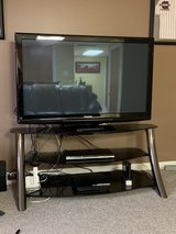 TV stand with 50in tv in Lockport, Illinois